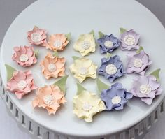 Fondant flowers with brooch centers and leaves for Spring