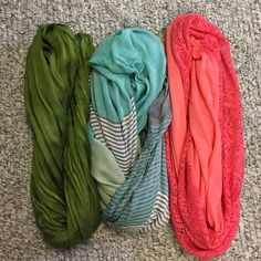 3 infinity scarf bundle NWOT 3 darling infinity scarves none have been worn. But tags have been removed. They are wrinkles from storage. Pink/lace scarf is from target xhiliration brand about 35 in in length and 9 inches across. Multi colored infinity was purchased from an online boutique 30.5 inches in length 32 in across. Moss green scarf is 31.5 in length and 25 in across. Fabric is meant to be wrinkled. Purchased from Bohme boutique. Xhilaration Accessories Scarves & Wraps
