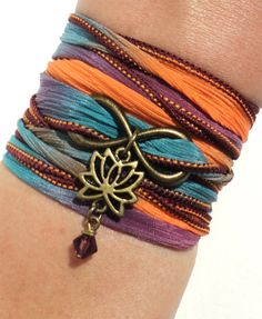 This listing is for one Lotus Flower silk wrap bracelet. It can also be used as a necklace or anklet. It features a hand dyed earth tone