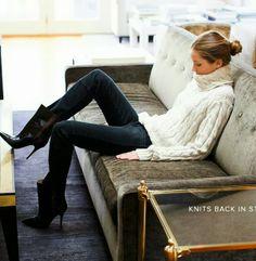 Dark wash skinny jeans, black stiletto boots, chunky white knit