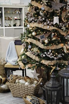 burlap garland with rustic jingle bells, garlands of real cotton, huge gilded pinecones (I WANT!) and rustic stars + mini chalkboard ornaments {Perfectly Imperfect's new retail shop}