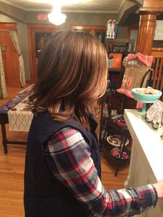 Rich brunette with caramel highlights on mid length angled bob  #balayage