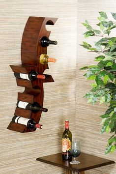 Calabria Wall Mount Wine Rack I want one of these sized for 2 liters of pop!