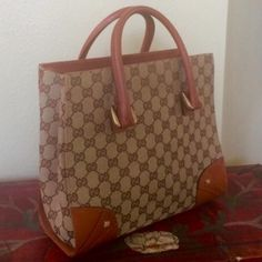 ✨AUTHENTIC GUCCI TOP HANDLE✨ Authentic GG pattern small top handle bag.  This bag is in excellent condition.  Inside cellphone pocket and one zip pocket.TRADESPAYPAL Gucci Bags Satchels
