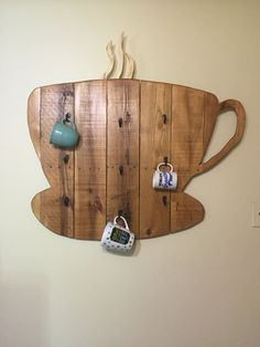 Coffee mug rack made from a pallet and stained with coffee.