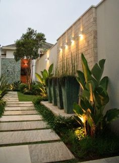 Have you just bought a new or planning to instal landscape lighting on the exsiting house? Are you looking for landscape lighting design ideas for inspiration? I have here expert landscape lighting design ideas you will love. Modern Landscape Design, Modern Landscaping, Landscape Architecture, Landscaping Ideas, Tropical Backyard Landscaping, Landscaping Shrubs, Farmhouse Landscaping, House Landscape, Landscape Walls
