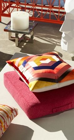 In a bold yet familiar vernacular, vibrant colors burst from a quilt-like design on the Trina Turk Hexagon Outdoor Pillow.   Porta Forma