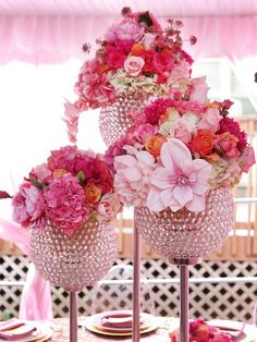 gorgeous pink flowers in a crystal centerpiece. wedding centerpiece