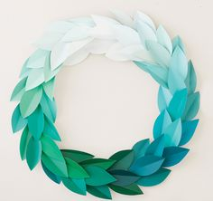 Paint Chip Wreath: We know you're probably going to be spending a good chunk of change on all those nifty gifties. So you want a wreath that's practically free to make — like this one.