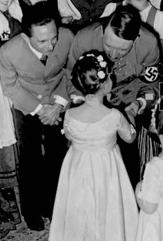 Adolf Hitler with Joseph and Helga Goebbels. Helga was killed by her parents in the Berlin bunker as the Nazi empire crumbled. Poor little thing :(