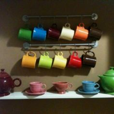 Bygel hanging rods by #Ikea, holding Fiesta mugs we use with vintage/collection Fiesta below.
