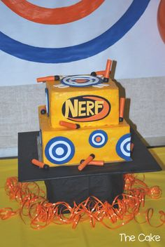 We did this cake in buttercream and then added the shapes and darts that we had pre-made out of fondant.