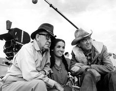 """John Ford, Linda Cristal and Jimmy Stewart on the set of """"Two Rode Together"""" (1961)"""