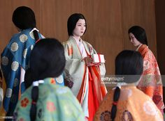Japanese women dressed in Heian Period costumes participate in the first ' Karuta' card game of new year at Yasaka Shrine on January 2014 in Kyoto, Japan. The traditional game is played each year. Heian Period, Traditional Games, Period Costumes, Japanese Culture, Card Games, Sari, Kyoto Japan, Storms, Poem