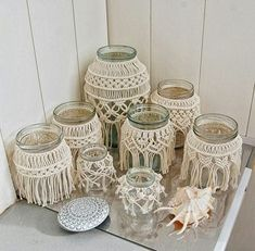 39 Stunning Macrame Wedding Ideas To DIY or Buy macrame beach wedding jar covers for lights of low budget lovely macramé ideas for home decoration which bring a unique design and ease to apply in various rooms of the house.Cranking out macrame Diy Macrame Wall Hanging, Macrame Art, Macrame Projects, Macrame Mirror, Macrame Curtain, Art Macramé, Wedding Jars, Rustic Wedding, Wedding Ideas To Make