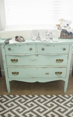 Distressed dresser as a changing table