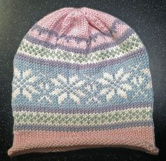 Ravelry: Simple Fair Isle Roll Brim Baby/Toddler Hat pattern by Dru Lundeng Mandelbaum
