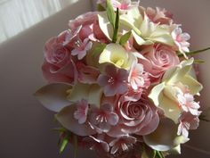 Featuring cherry blossom, roses, orchids, calla lily, and bamboo shoots.