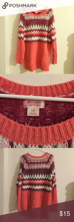 Large Coral Mossimo Sweater It's a beautiful coral color, has never been worn but doesn't have tag. It has a cute pattern on the top half of the sweater. Mossimo Supply Co Sweaters Crew & Scoop Necks