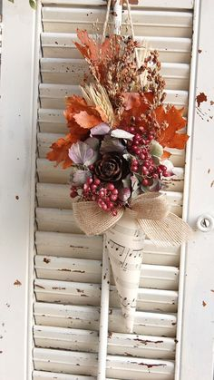 diy using dried or silk flowers and leaves; make a cone using cardboard overlay with vintage sheer music