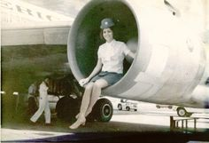 1970s Saigon, Venice poses in the engine of a Pan Am Boeing 707 during a Saigon transit.