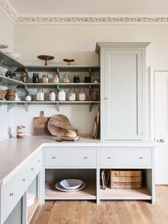 Drawers with open cabinet underneath. Open shelving ends at cabinet looks more finished than shelves alone. A classic twist.