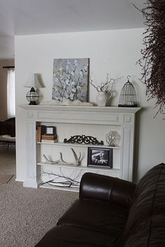 i like this one for a fake fireplace in the living room.  not trying to make it look like something it isnt, and also gives more display space!  Light my Fire: Mantles Galore - Remodelaholic | Remodelaholic