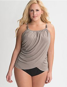 Designed to flatter all your fabulous curves, this slimming maillot by Miraclesuit features beaded straps and a stunning draped overlay. Supportive underwire cups make the most of your shape, keeping you perky in the pool or out. Scoop neckline exudes confidence and stunning style while accentuating the bust. Graceful moderate leg cut elongates and slims the legs for a look too irresistible to hide under the cabana. lanebryant.com