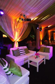 Lounge area in the tent | It's important to keep lounge areas feeling intimate, yet still open. Leave one side of the lounge area open so guests can still mingle.