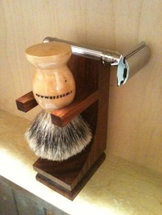 Nice shaving kit and a nice safety razor or a straight razor.  ☠ | Walnut Brush and Razor Stand.