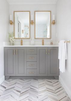 I like the gold hardware on the light gray cabinets, and the interest the floor…