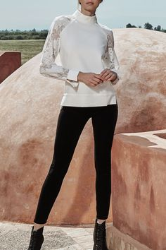 The SHIREL is a Moon White sweater inspired top with raglan lace sleeves and a mock collar. White Shirts, White Sweaters, White Blouses, Lace Sleeves, Designer Dresses, Bell Sleeve Top, Normcore, Dresses For Work, Moon