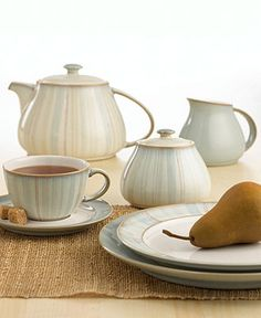 """Denby """"Mist"""" Dinnerware Collection - With a pale blue glaze and warm, reddish-brown accent trim, this charming dinnerware and dishes collection lends tranquility at every meal. Stoneware. Dishwasher, microwave, oven and freezer safe. Made in England."""