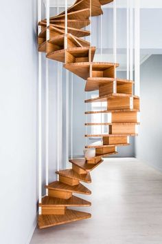 As part of an apartment renovation in Brussels, design firm Jo-a created a central staircase that shows off the helix of the spiral.