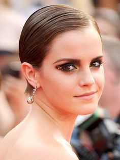 And now Emma Watson rocks slicked-back hair and bedazzled lids.
