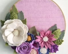 Handmade felt flower embroidery hoop. Hoop measures 9. Please note: this hoop cannot be hung by the metal piece or it will hang crooked due to the weight of the flowers.