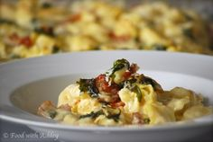 Cheese Stuffed Sacchettini Baked in a Cream Butter Sauce with Spinach & Butter