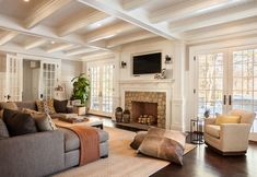 A stylish Colonial home with traditional interiors was designed for family living by Garrison Hullinger Interior Design, located in New Canaan, Connecticut. Cozy Family Rooms, Family Room Design, Home And Family, Open Family Room, Family Life, Home Living Room, Living Room Designs, Living Spaces, Luxury Interior Design