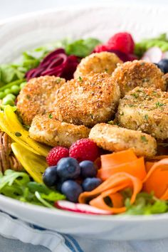 Fried Goat Cheese Salad - Fresh spring vegetable salad recipe with arugula, beets, carrots, peas, avocado and raspberry poppyseed dressing | jessicagavin.com