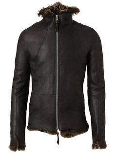 Black Leather jacket with multi-brown shearling lining from The Viridi Anne. Shearling lining peeps out at the collar, cuffs and hem. Stand up collar leads into an exposed zip down front. Long sleeves. Darts for shaping. Exposed seams.