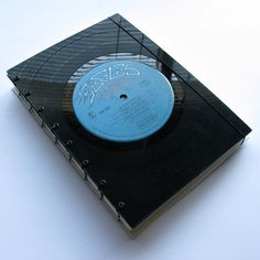 20 DIY: Unique and Interesting Vinyl Record Projects - Notebook - Get some sheets and make yourself a vinyl record notebook