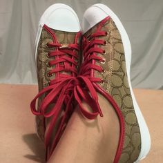 Coach Signature Tan & Brown Sneakers These shoes are Brand New/Never Worn and are in PERFECT CONDITION. They are trimmed in red and are gold accented. Coach Shoes Sneakers