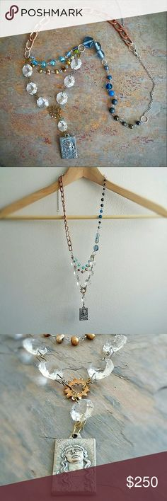 """Boutique 1OAK Religious Medal Necklace Antiqued silver tone vintage Jesus medal pendant, vintage chandelier crystals, antiqued golden freshwater pearls & faceted glass aqua beads rosary style chains, rose gold tone chunky chain, ombre blue to gunmetal black glass beads, pearls, metal, and semi-precious stone beads. 24"""" long,  3.5"""" adjustable extension, 5.5"""" drop Jewelry Necklaces"""