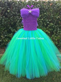 Welcome To Sweetest Little Tutus! **Please read my shop announcements before placing any orders to see current turnaround time!**  This Ariel inspired tutu dress is perfect for any little girl that loves The Little Mermaid! All my tutu dresses include a lined crochet top for better coverage, extra warmth, and for overall added comfort. This Ariel dress includes 3 layers of emerald green and turquoise tulle for a beautiful ball gown appearance. A satin purple ribbon on the lined purple…