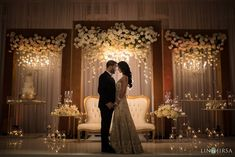 Ivory flowers in a gold frame for reception maharani wedding stage backdrop deco. Wedding Ceremony Ideas, Indian Wedding Receptions, Wedding Stage Design, Wedding Reception Backdrop, Wedding Stage Decorations, Wedding Mandap, Wedding Designs, Wedding Table, Wedding Cakes
