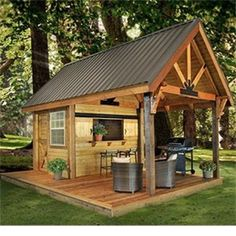 I love this! Great storage for deep freezer and alcohol...I love the covered area for Kenny's grills...what a great little cook out spot!