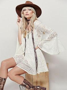 Goldie Swing Dress   Flirty, swingy mini dress with a V-neckline and statement flared sleeves. In a sheer crochet lace, this dress includes a detachable slip.