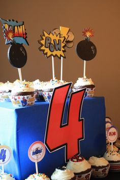 Cheap & easy cupcake display - wrapped boxes (comic book pages?) And giant #
