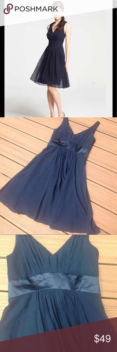 Ann Taylor Georgette Navy Blue Dress Size 4 Gorgeous Ann Taylor navy blue silk dress.  This Georgette style has a deep V neckline, full body skirt, and fitted waist.  Perfect for a wedding or a bridesmaid dress!  EUC, size 4. Ann Taylor Dresses Midi