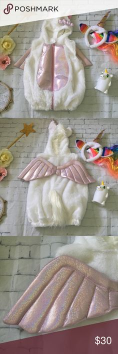 Baby Unicorn Zip-Up Costume 🦄 Baby Unicorn Zip-Up Costume 🦄. Plush costume  with iridescent pink belly and wings. Featuring tuft of a mane, iridescent pink plush horn, fluffy tail. Zips up the front and velcro at the neck. Complete costume in one piece- perfect for school and daycare as it can easily be removed for nap time! Just pair with a cute white or pink outfit to complete the look! Perfect for Halloween or every day magic dress up. Smoke free, pet free home. Matching Mommy Headband…